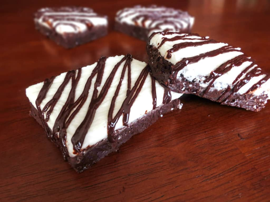Peppermint Pattie Brownies. A thick, creamy peppermint layer on top of a super fudgy brownie. Tastes just like a peppermint pat tie in brownie form! So good.