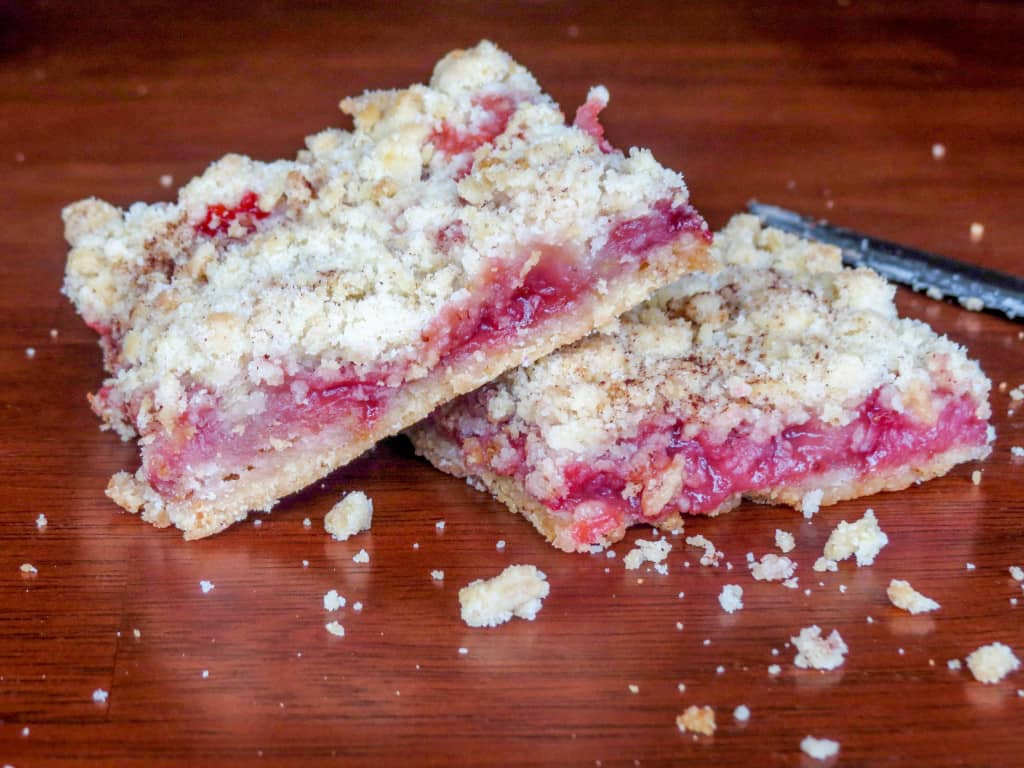 Strawberry Crumble Bars. The quickest, easiest most delicious breakfast treat! A buttery crust covered with a nice thick layer of juicy, gooey strawberries, sprinkled with some more buttery deliciousness on top!