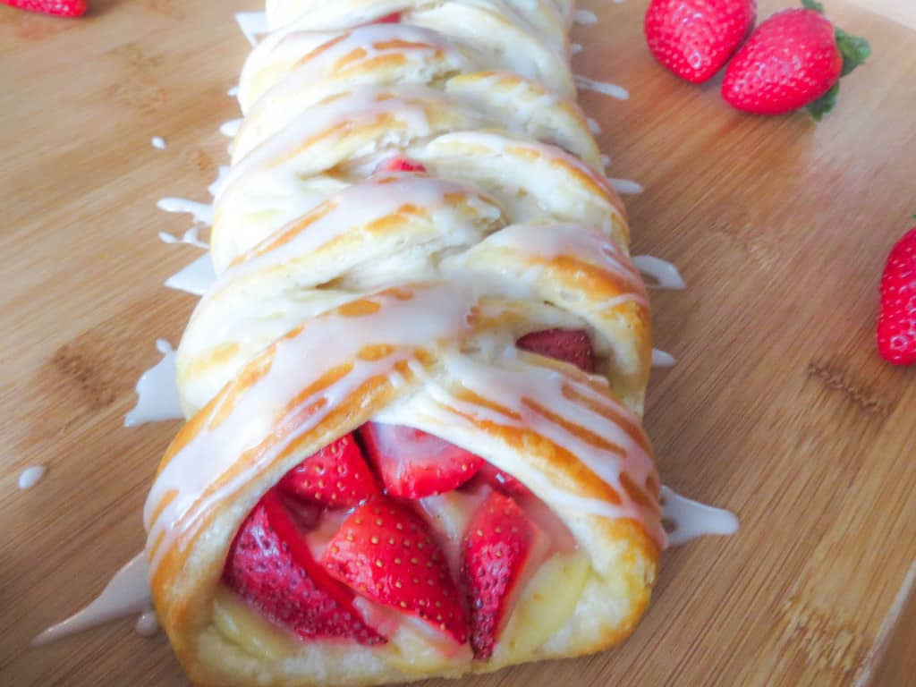 Strawberry Danish Braid. One of my favorite breakfasts! A delicious, sweet filling of strawberries and pastry cream. The dough is so simple to make and takes no time at all!