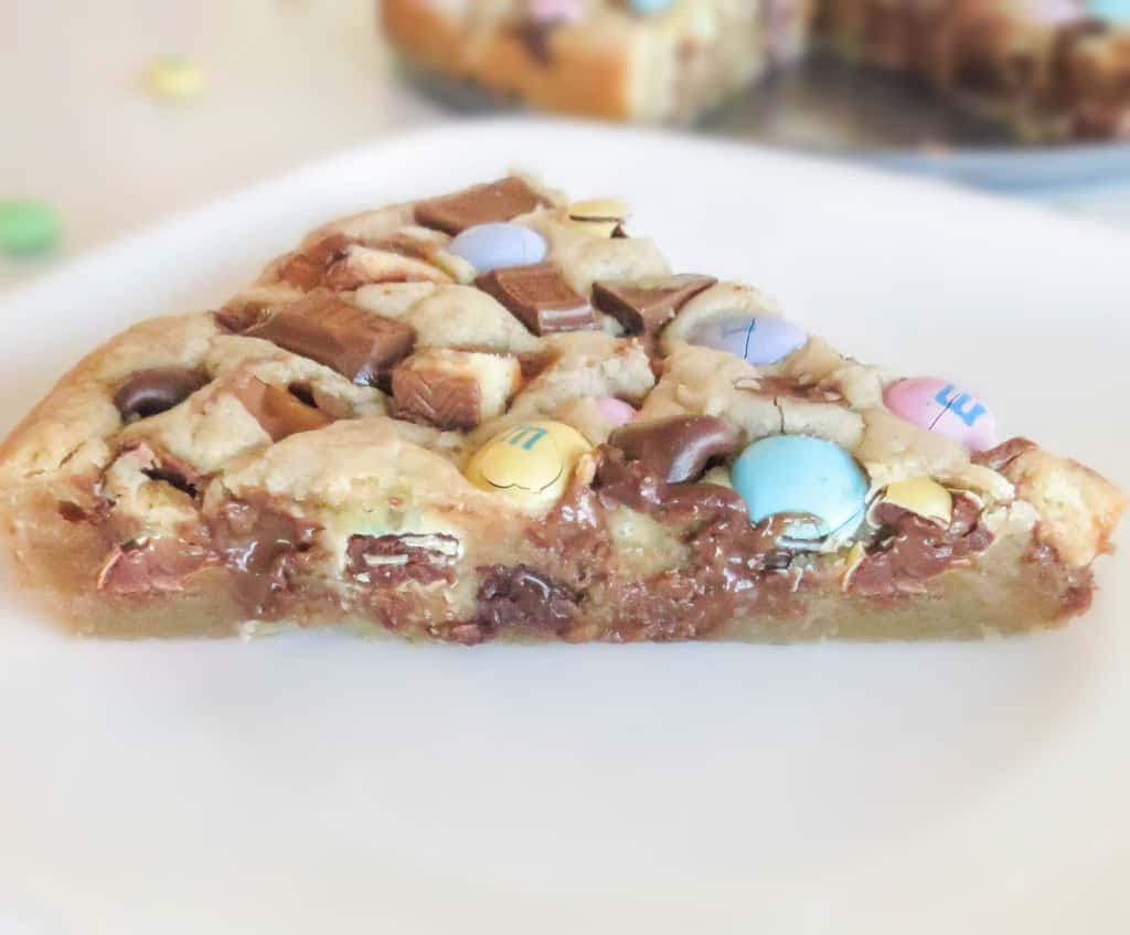 Loaded Soft and Chewy Twix M&M Cookie Cake