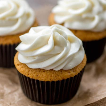 The fluffiest, most flavorful pumpkin cupcakes topped with the creamiest cream cheese frosting. I make these every year for Thanksgiving! - Sprinkle Some Sugar