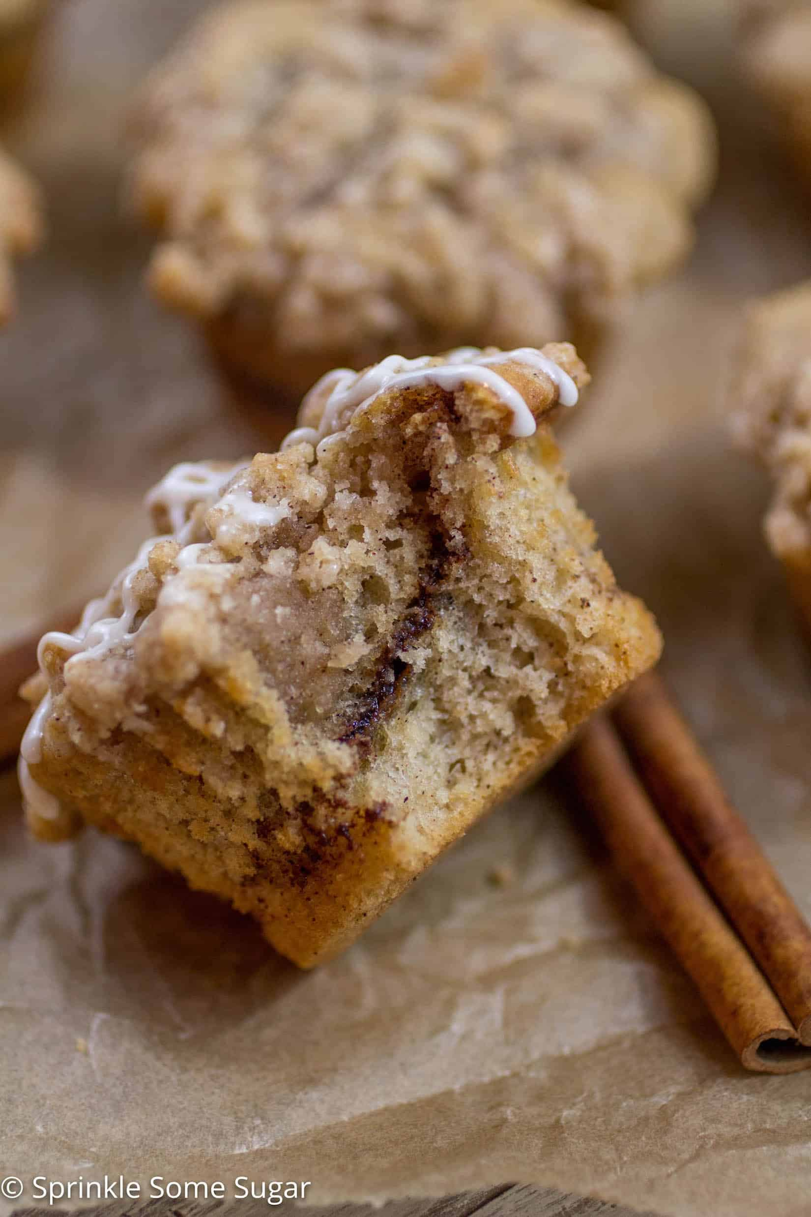 Cinnamon Swirl Coffee Cake Muffins - The most tender muffins with a gooey cinnamon center and topped with a sweet crumb topping!