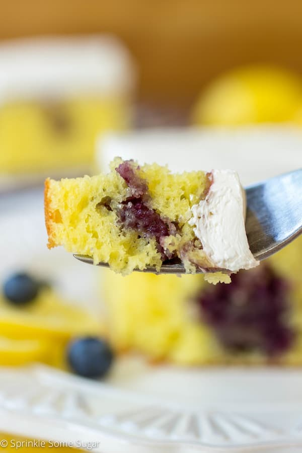 Lemon Blueberry Poke Cake - Sprinkle Some Sugar