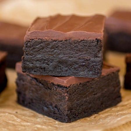 Triple Dark Chocolate Truffle Brownies stacked.