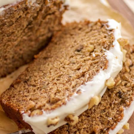 slice of banana walnut bread with cream cheese frosting