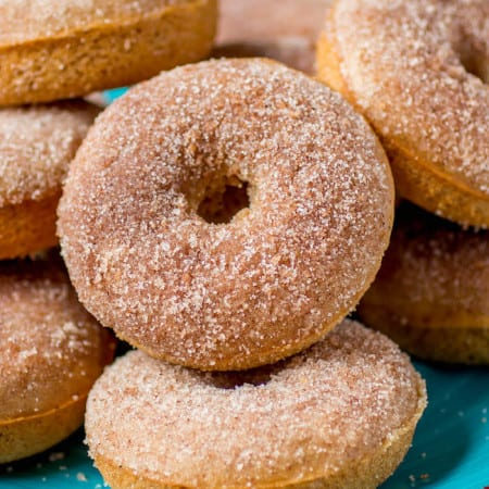 Fluffy spiced donuts spiked with apple cider and rolled in cinnamon spice sugar. They're baked rather than fried and you won't miss it!