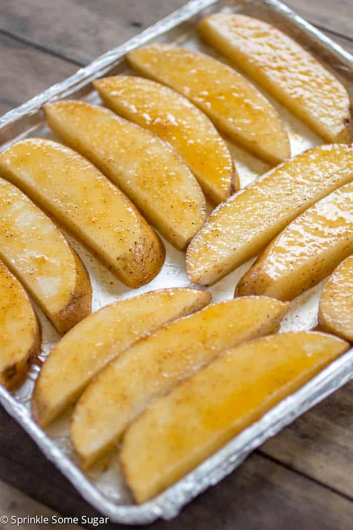 Crispy Potato Wedges - Perfectly spiced potato wedges that are perfectly crispy on the outside and tender on the inside.