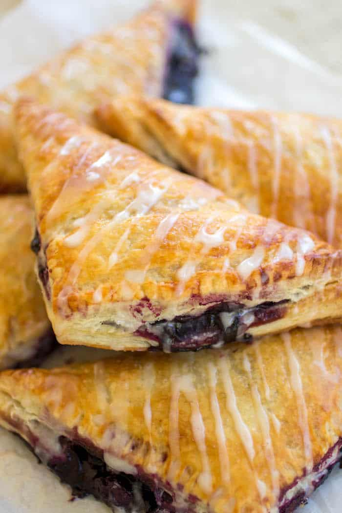 Blueberry Turnovers - Flakey pastry dough is filled with gooey homemade blueberry filling.