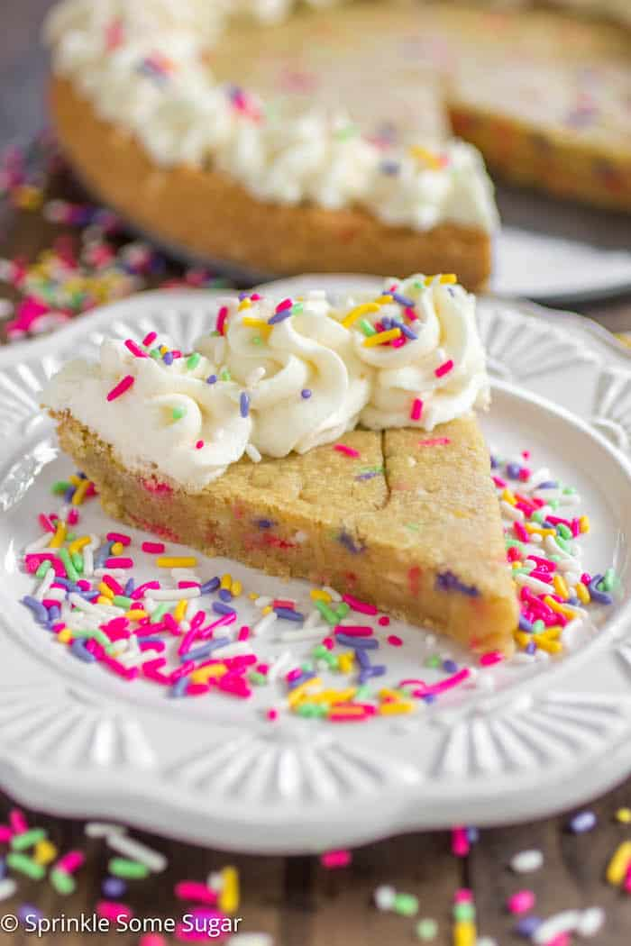 Funfetti Sugar Cookie Cake - A soft and chewy sugar cookie cake filled with sprinkles and topped with a creamy vanilla frosting.