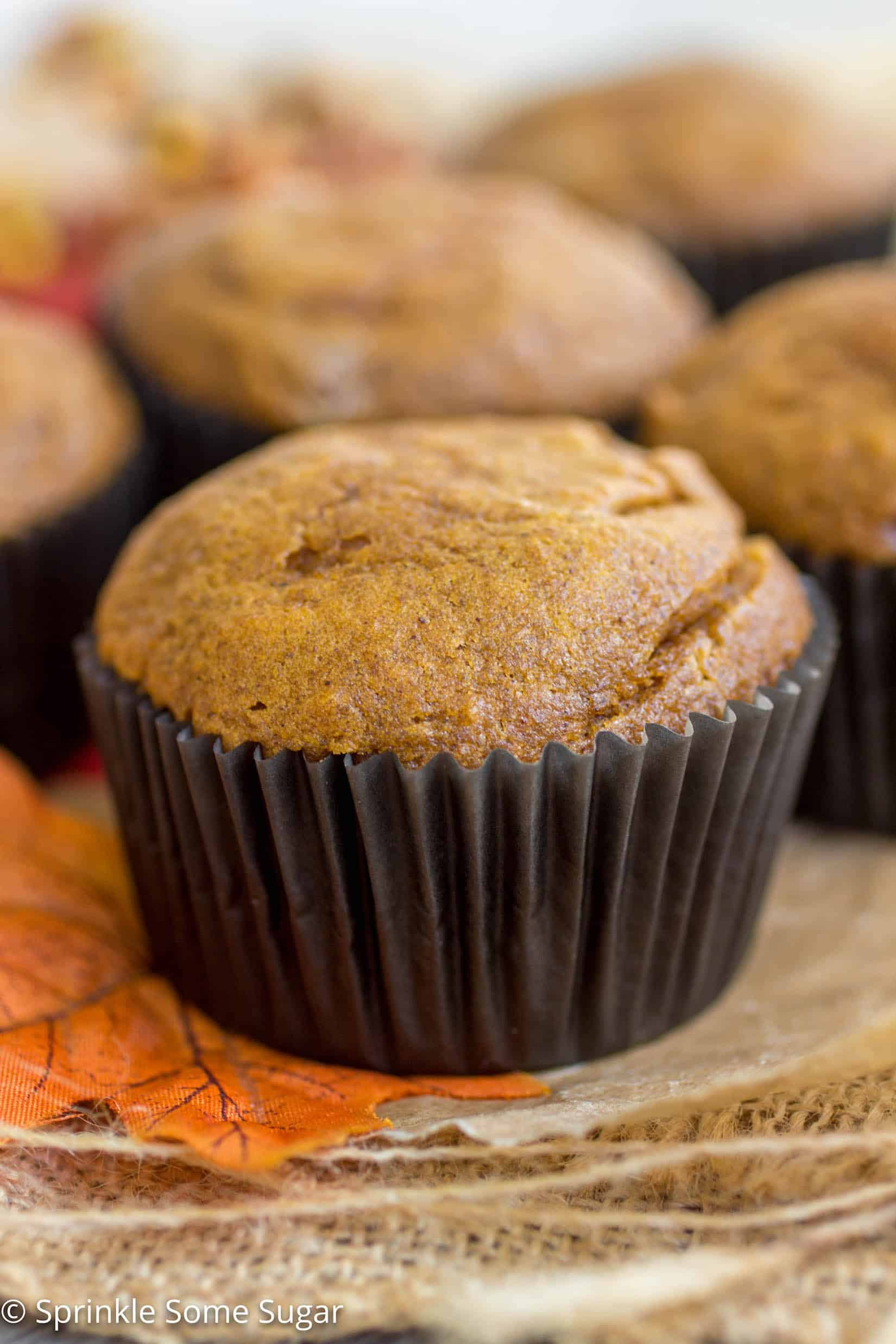 Cheesecake-Filled Pumpkin Spice Muffins - Deliciously spiced, moist and tender pumpkin muffins stuffed with a sweet cheesecake filling!