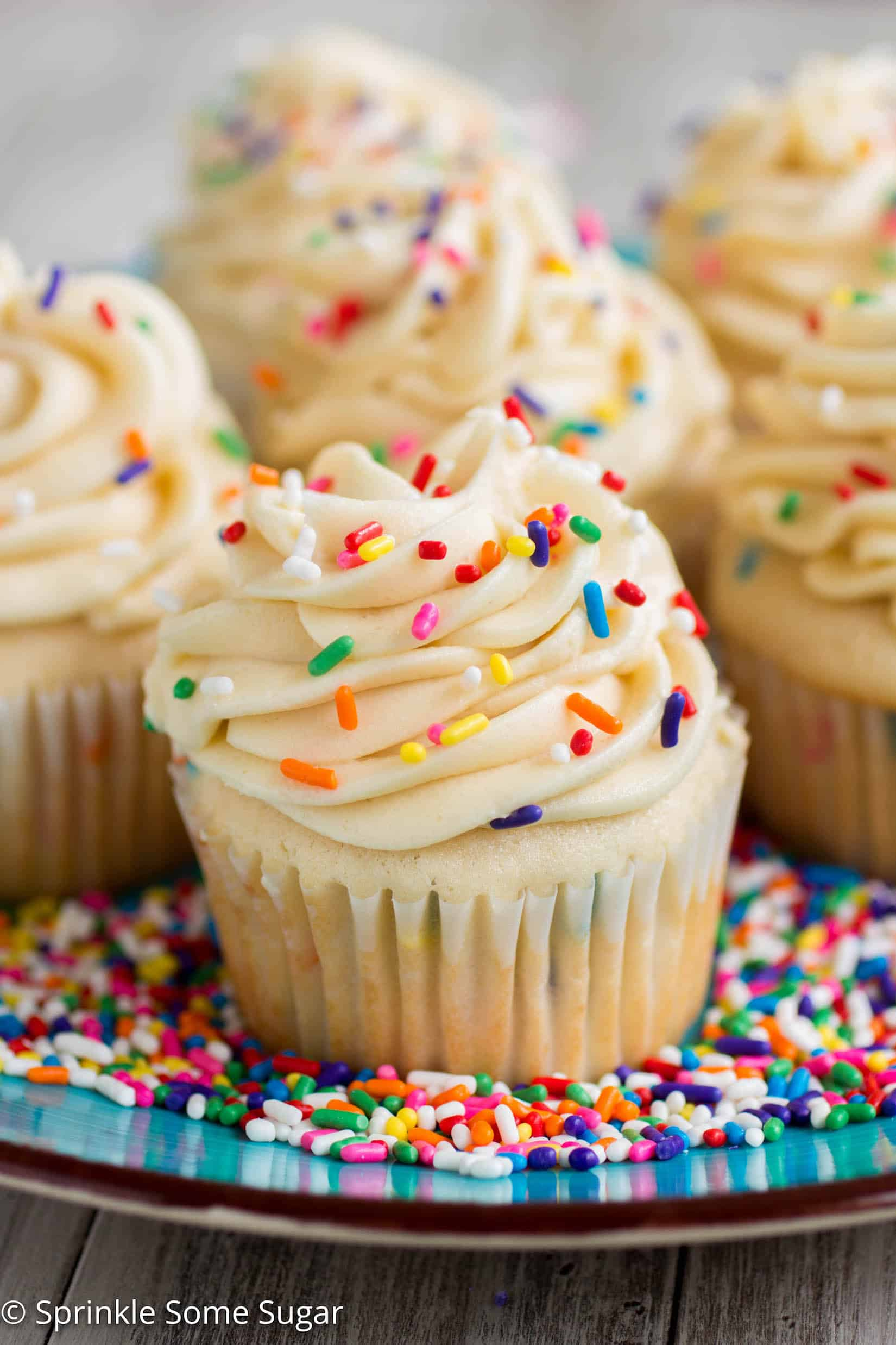 Funfetti Cupcakes with Cake Batter Frosting - My favorite basic fluffy vanilla cupcakes chock full of sprinkles and topped with a creamy cake batter frosting!