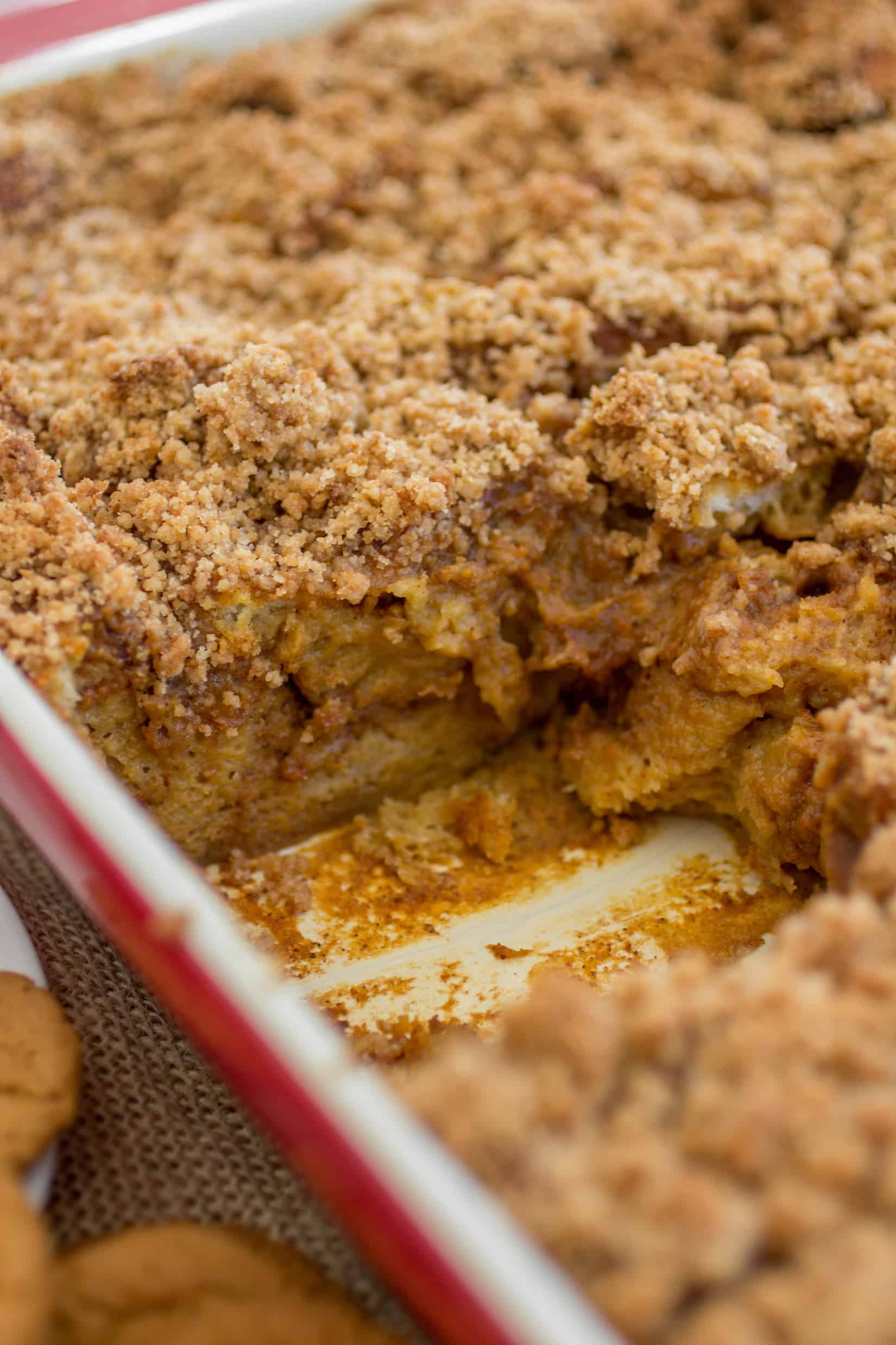 This melt-in-your-mouth bread pudding tastes like pumpkin pie but with an added spiced flair from the gingersnaps baked inside in the sweet and spicy crumble on top! - Sprinkle Some Sugar