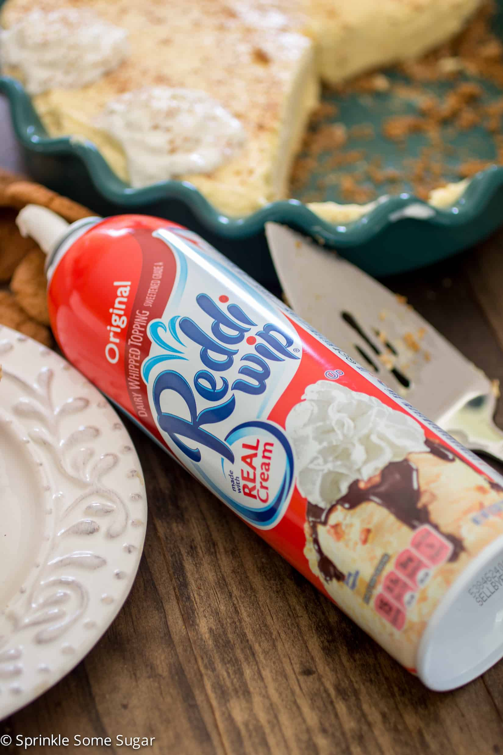 A spicy gingersnap crust is filled with a super creamy, flavorful eggnog filling and topped with Reddi-wip®. - Sprinkle Some Sugar