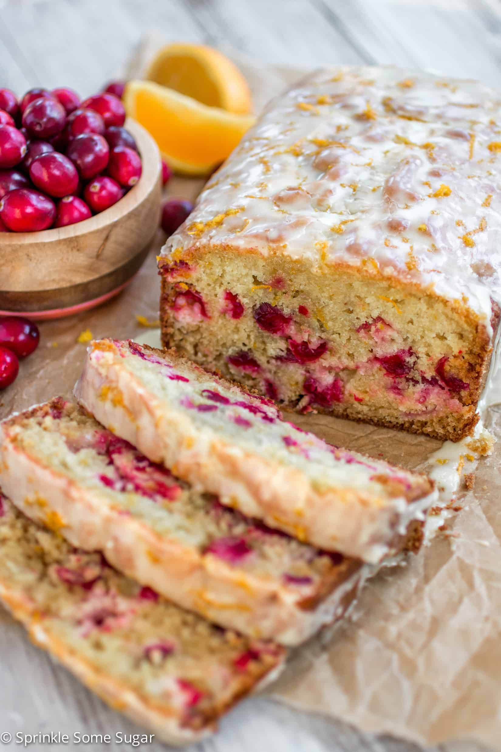 Super moist orange bread studded with juicy cranberries and topped with a sweet, fresh orange glaze. - Sprinkle Some Sugar