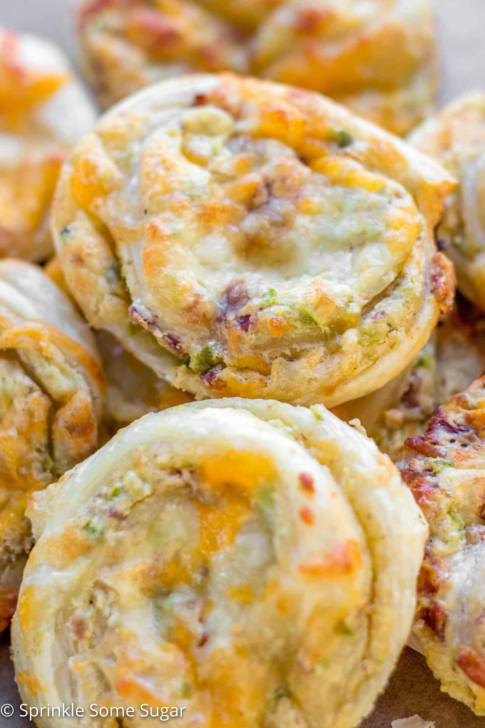 Cheesy Jalapenño Popper Pinwheels - These cheesy jalapeño popper pinwheels incorporate everything you love about a traditional jalapeño popper, all wrapped up in sweet puff pastry dough!