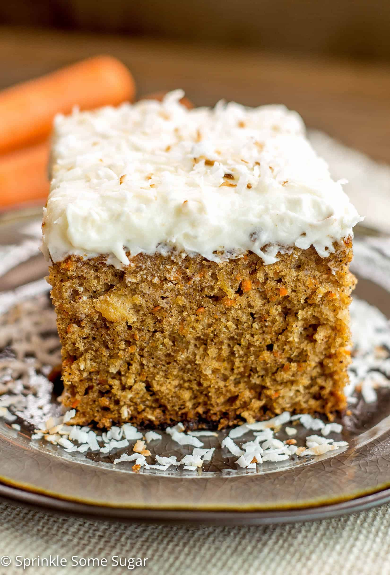 Pineapple Carrot Coconut Cake with Coconut Cream Cheese Frosting - This perfectly moist carrot cake is chock full of carrots, pineapple and coconut. Topped with hefty layer of my favorite coconut cream cheese frosting!