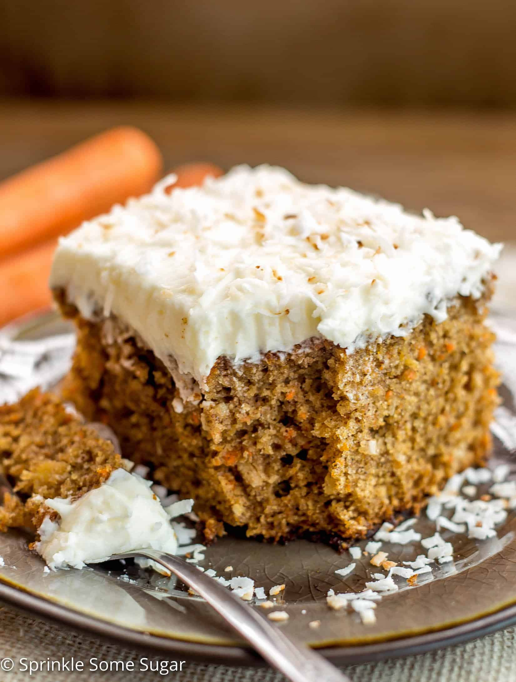 Pineapple Coconut Carrot Cake with Coconut Cream Cheese Frosting - This perfectly moist carrot cake is chock full of carrots, pineapple and coconut. Topped with hefty layer of my favorite coconut cream cheese frosting!