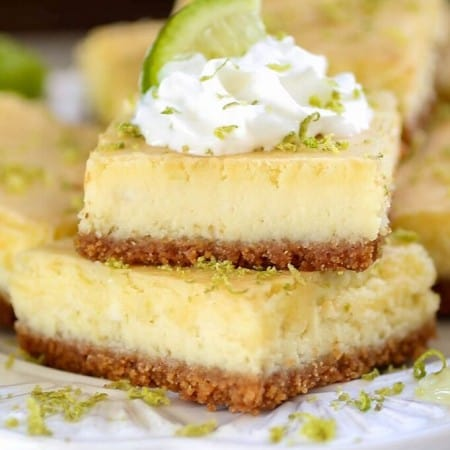 Key Lime Cheesecake Bars - Tart, tangy and sweet, these creamy Key Lime Cheesecake bars are sure to be a crowd pleaser!