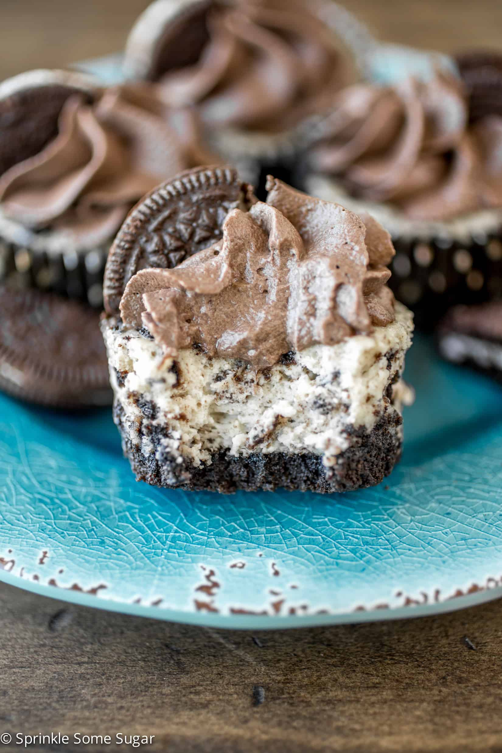 Mini Oreo Cheesecakes with Dark Chocolate Whipped Cream - These creamy mini Oreo cheesecakes with dark chocolate whipped cream are chock full of Oreos with an Oreo crust and topped with homemade whipped cream!