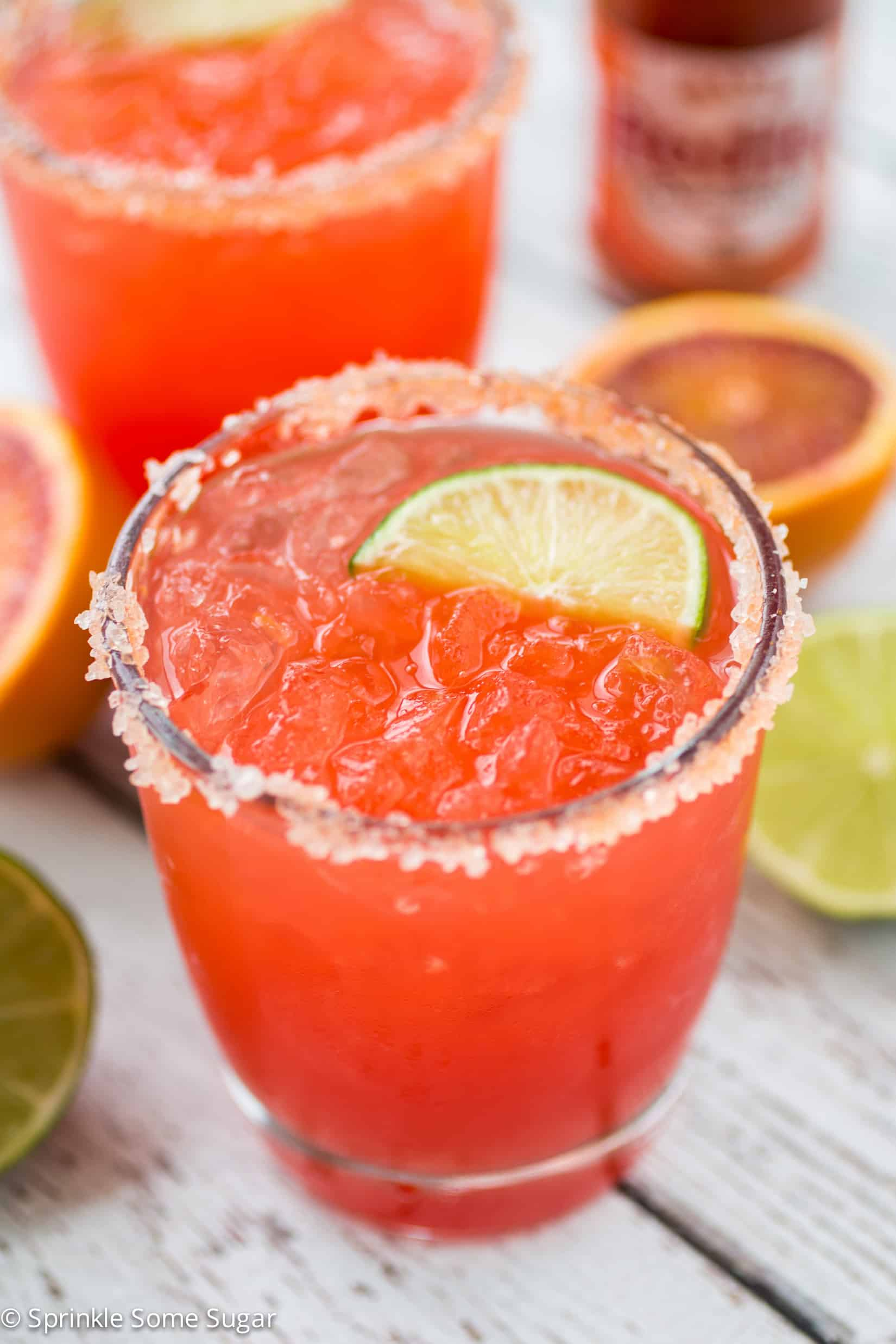 Spicy Blood Orange Margaritas - Margaritas made with freshly squeezed blood orange juice and a few dashes of hot sauce for a sweet and spicy kick!