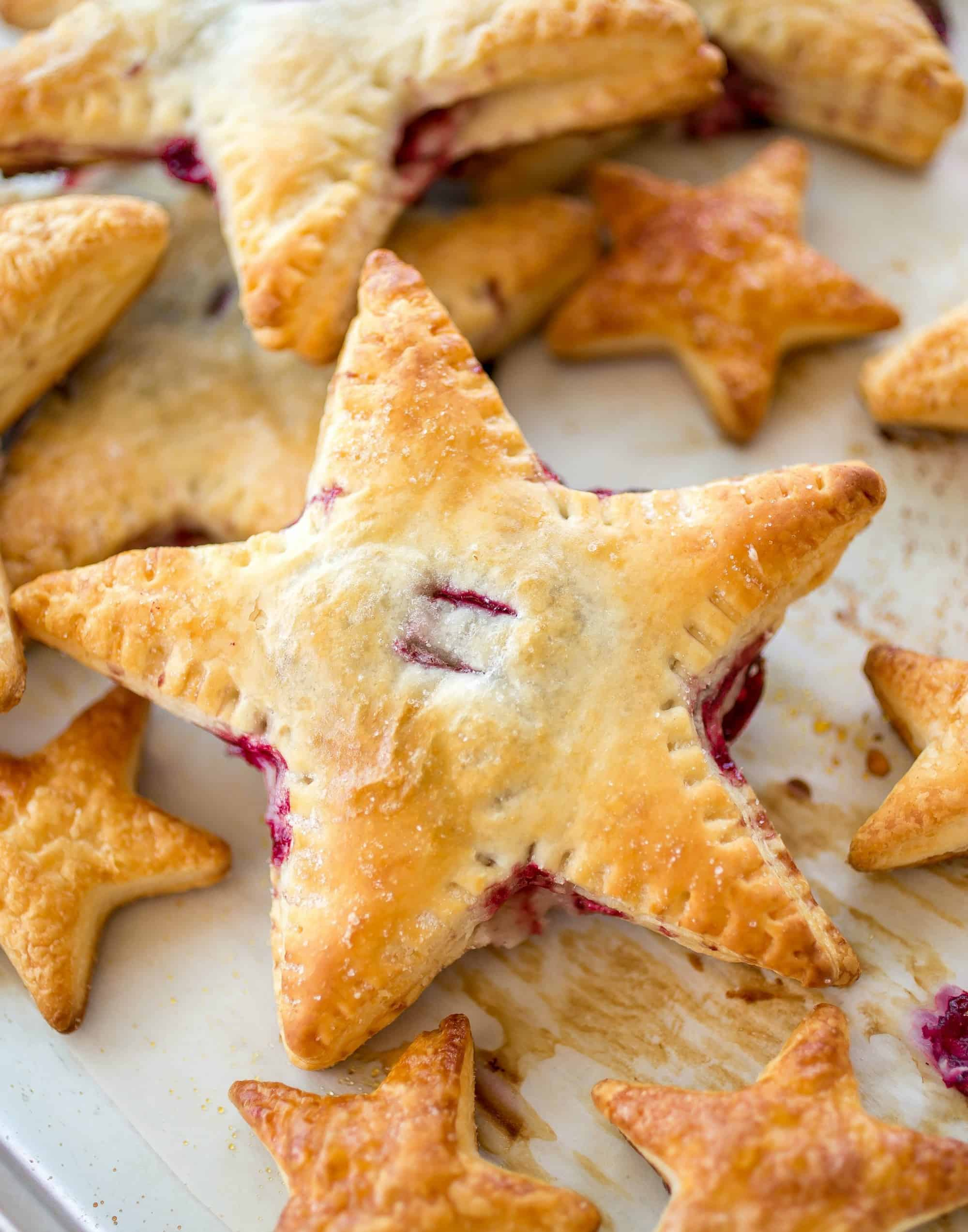 Cherries and Cream Cheese Danish Stars - These cherries and cream danishes are so much fun for the Summer holidays coming up! The dough is flakey, buttery, and crispy on the outside and the inside has a creamy cream cheese filling topped with some homemade cherry preserves!