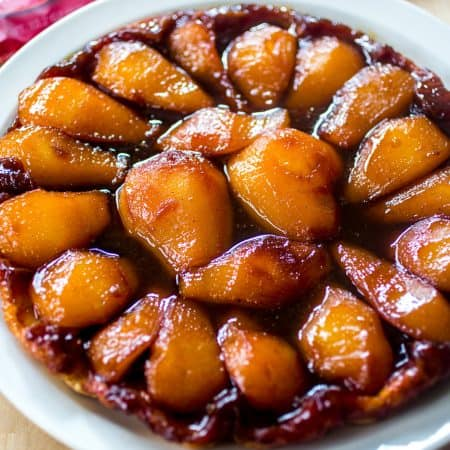 Pear Tarte - Juicy pears are smothered in a sweet sauce atop of a crispy puff pastry crust!