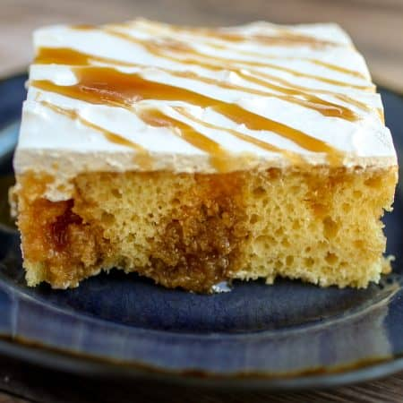Caramel Poke Cake - Light and fluffy yellow cake filled with gooey caramel and topped with a sweet whipped topping!