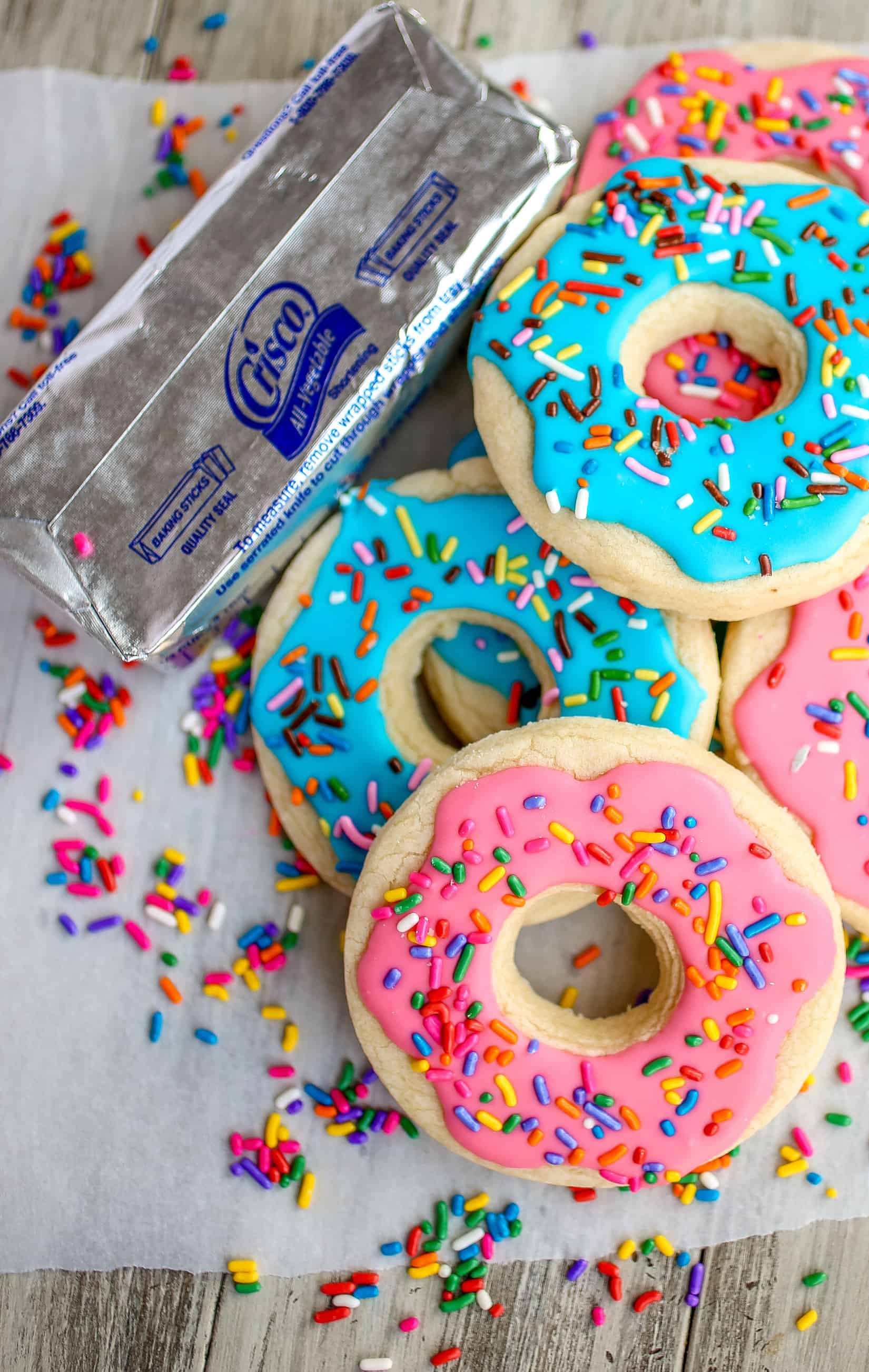 Donut Shaped Sugar Cookies with Royal Icing - Deliciously thick and soft sugar cookies decorated as donuts! These cookies will melt in your mouth!