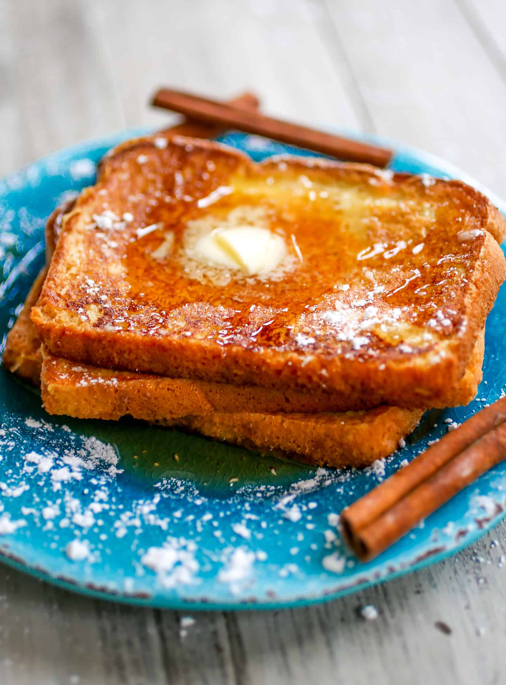 Eggnog French Toast - Sweet, lightly spiced breakfast perfection is what I like to call this eggnog french toast! The perfect holiday season breakfast!
