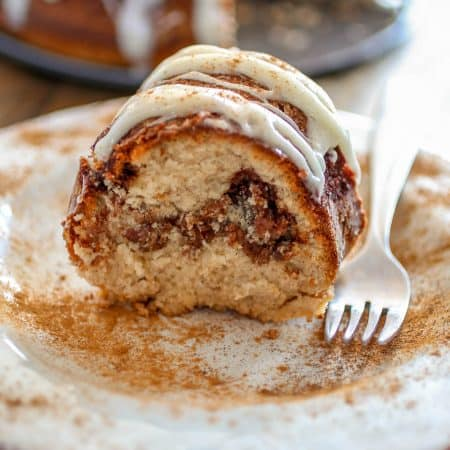 Cinnamon Roll Bundt Cake - From the gooey cinnamon swirl, to the iconic cream cheese icing on top, this Cinnamon Roll Bundt Cake is perfection for cinnamon roll lovers.