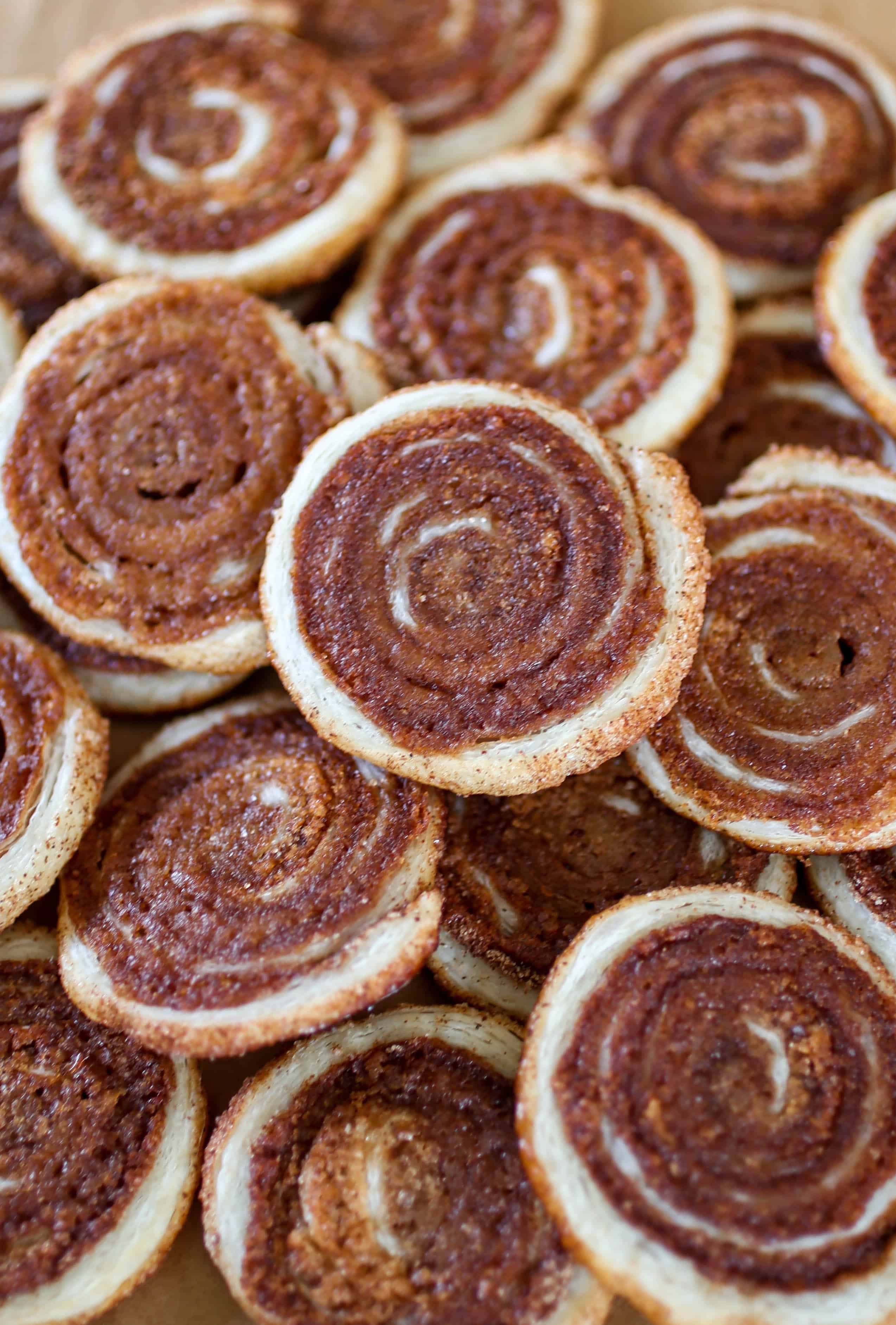 Cinnamon Sugar Puff Pastry Cookies - Puff pastry dough is rolled up in a sweet and spicy coating of cinnamon sugar, sliced into cookies and baked up to golden perfection!