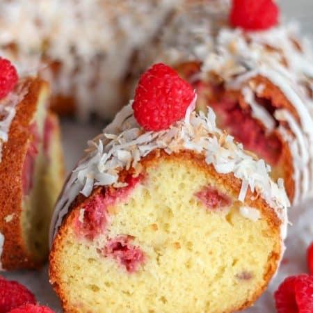 Lemon Raspberry Coconut Cake - A soft and fluffy lemon cake filled with coconut and juicy raspberries, topped with a coconut glaze!