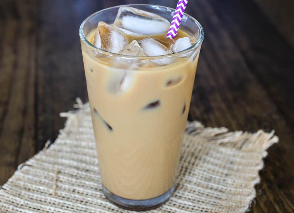 An easy, delicious homemade iced vanilla latte made at home with just a few simple ingredients! - Sprinkle Some Sugar