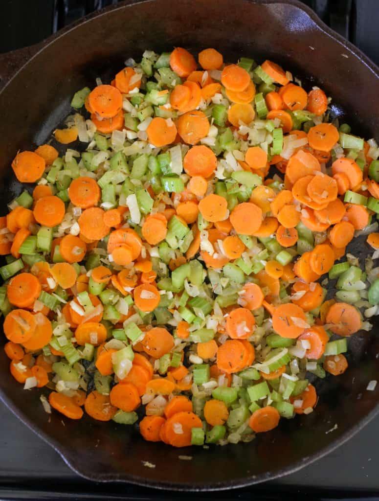Sautéing carrots, celery and onion.