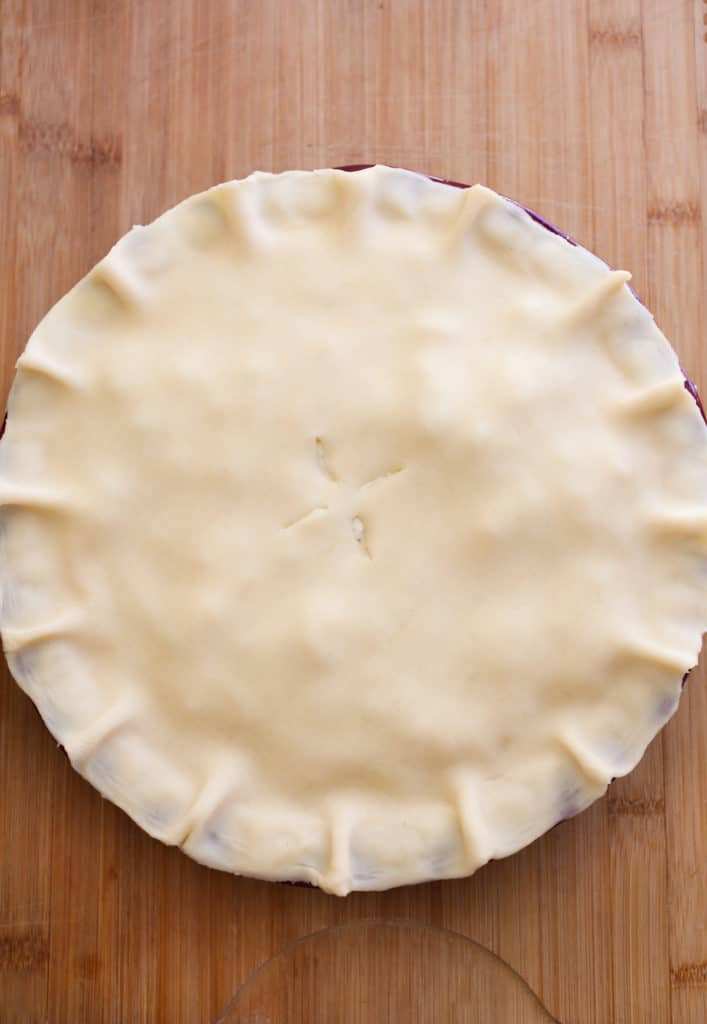 Second crust placed on top of pie.