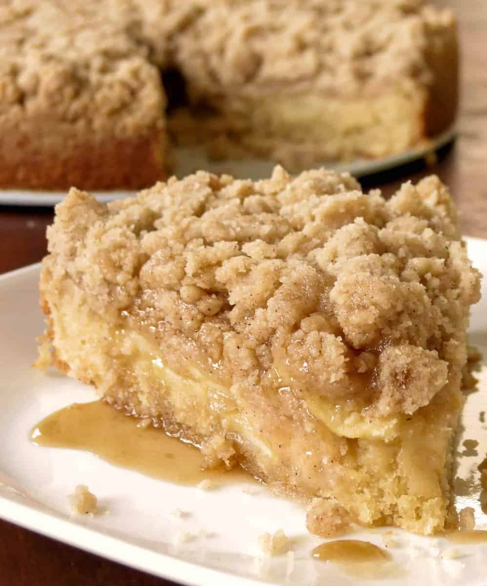 Apple Crumb Coffee Cake on a plate with caramel oozing out.